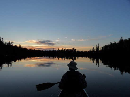 Norm paddling toward camp.