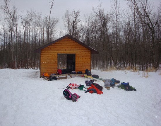 A storage shed protects gear and makes a nice gathering spot in the Bay View School Forest, Proctor.