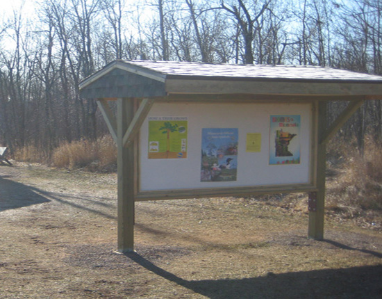 A kiosk features important information in the Bay View School Forest, Proctor.