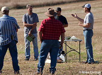 image of farmers talking about conservation efforts in the Chippewa River watershed.
