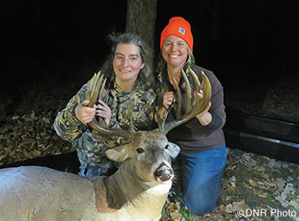 photo of hunters with trophy buck taken during a women's hunt in Itasca State Park.